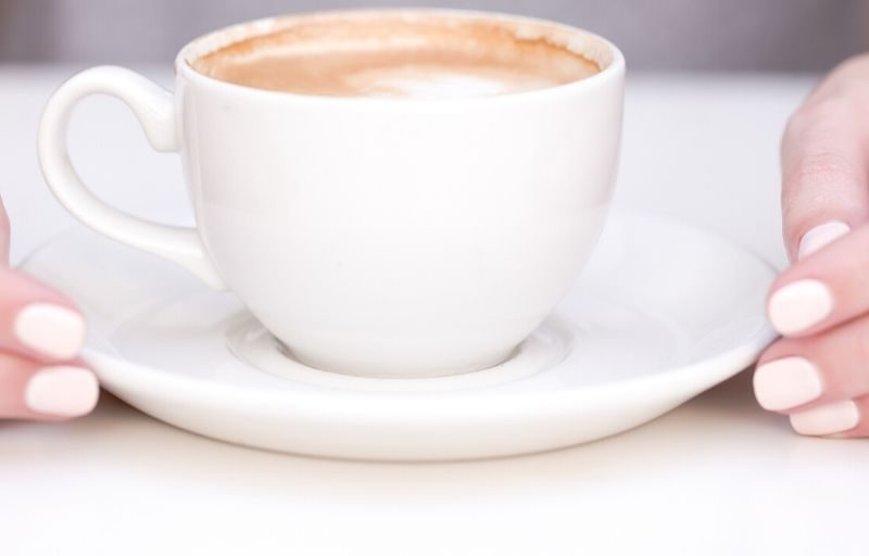 hands holding a coffee cup. The ABC's of how to live more intentionally