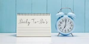A clock and daily to-do list. Learn how to stop wasting time on things that aren't important.