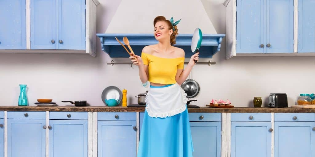 retro housewife posing in the kitchen. Why modern homemaking isn't what you think.