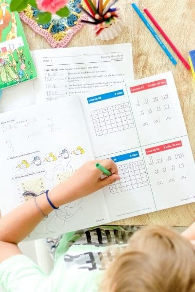 Child doing homework. The benefits of homeschooling