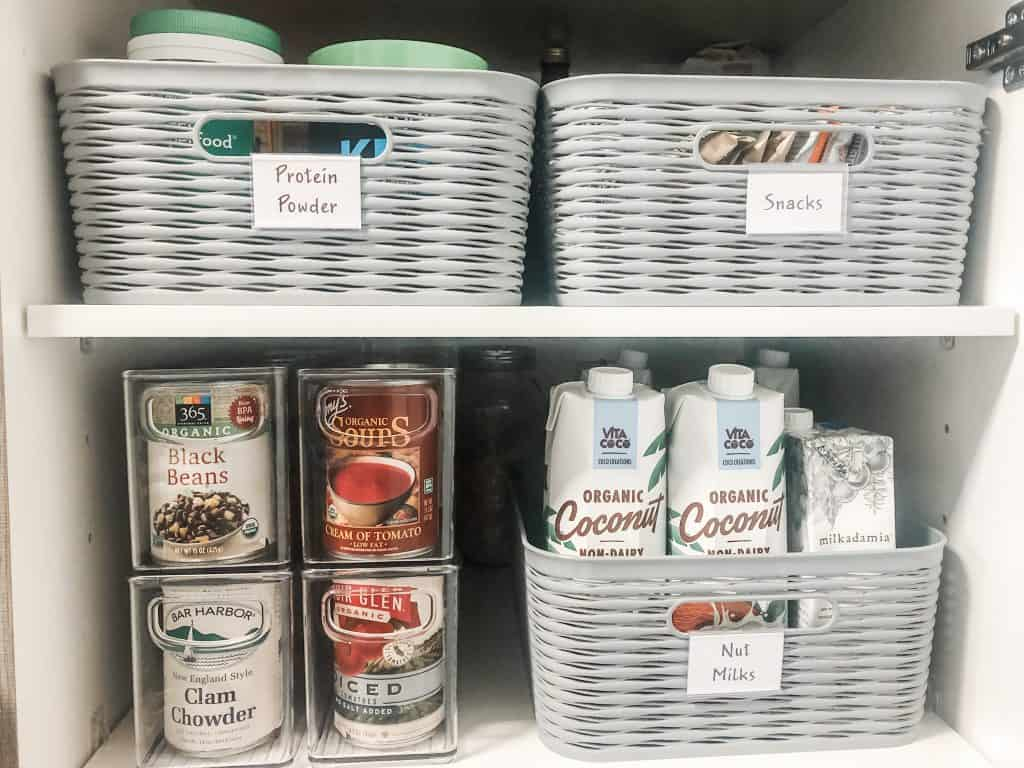 pantry inventory with labeled baskets and plastic bins