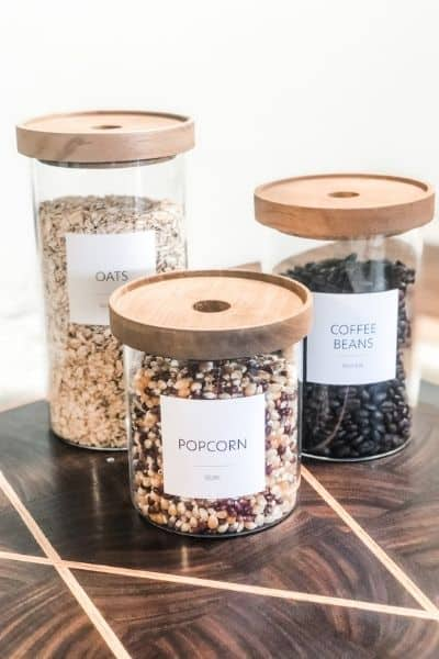 decanting can help with pantry inventory. canisters of dried goods